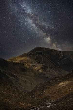 Stunning majestic digital composite landscape of Milky Way over