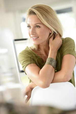 beautiful blond woman in office