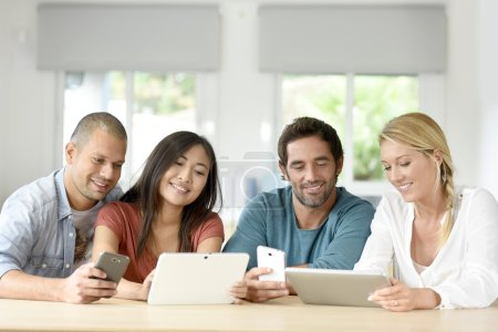 people meeting with tablets and smartphones