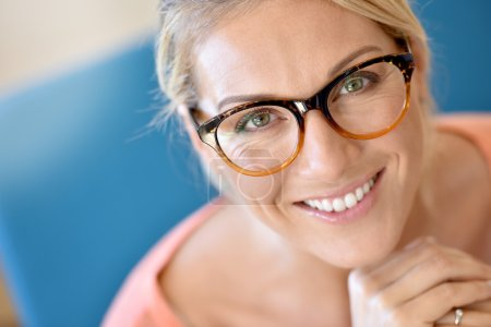 blond woman wearing eyeglasses