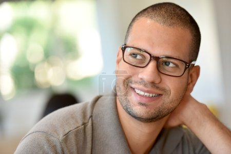 Hispanic guy with eyeglasses on