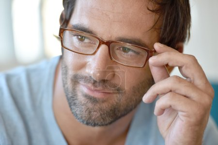 handsome man with eyeglasses on