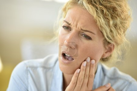 woman suffering toothache