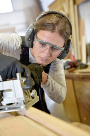 woman in woodwork training course