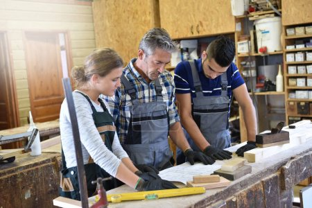 Students in woodwork training course