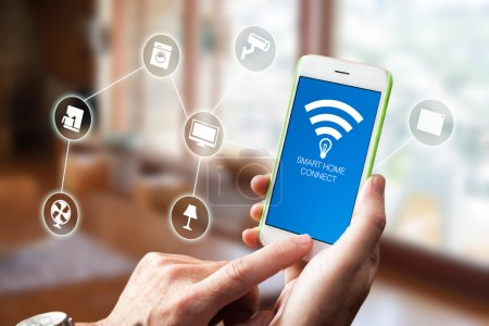 Photo for Using smart home app on phone. Smart home, remote control concept. - Royalty Free Image