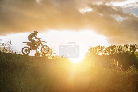 Motocross MX Rider riding on dirt track