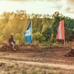 Постер, плакат: Motocross MX Rider riding on dirt track