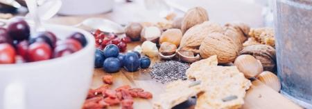 Photo for Superfood - variation of healthy superfoods on wooden background - Royalty Free Image