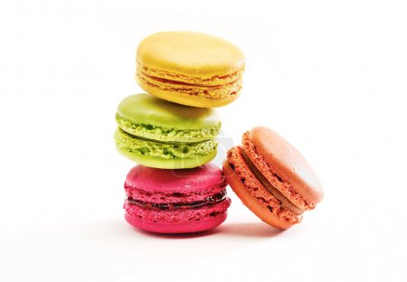 Photo for Fresh bright colored Macarons, or macaroons isolated on white background - Royalty Free Image