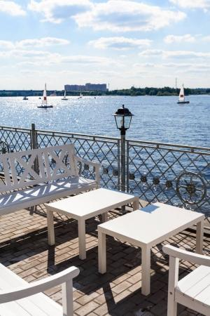 Empty tables on waterfront of Moscow Canal