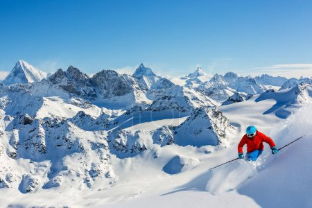 Man skiing in swiss  mountains