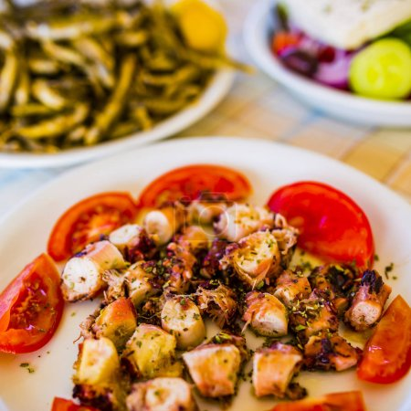 Seafood with chips and greek salad