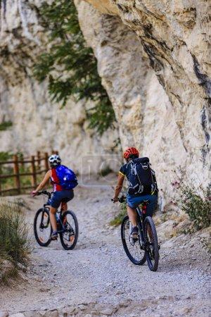 Mountain biking woman and young girl