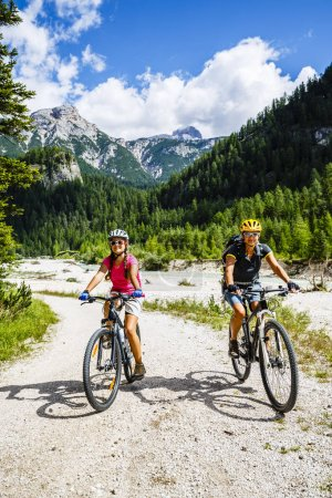 Mountain biking woman and young girl