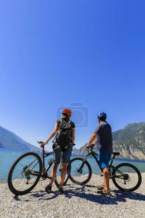 Mountain biking couple with bikes