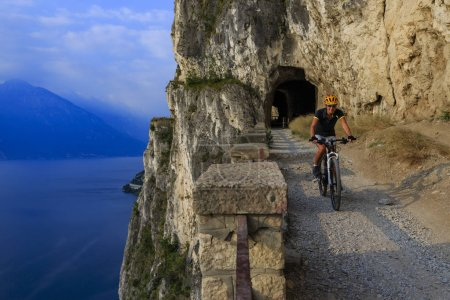 Mountain biking woman at sunrise