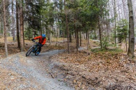 Mountain biker riding on bike in early spring mountains forest l