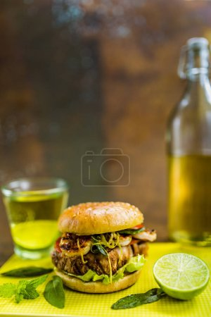 Tasty grilled tuna burger with lettuce and mayonnaise served wit