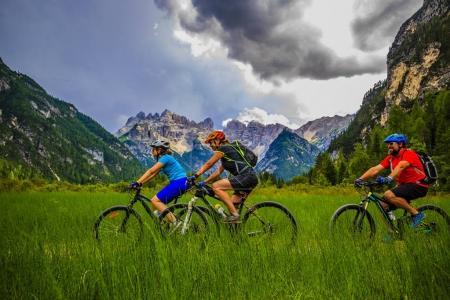 Mountain biking family with bikes on track, Cortina d'Ampezzo, D