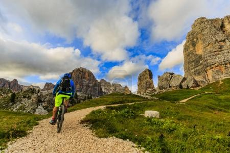 Cycling, View of cyclist riding mountain bike on single trail in