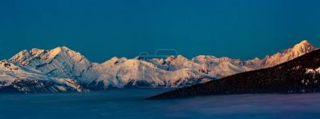 Scenic panorama sunset landscape of Crans-Montana range in Swiss