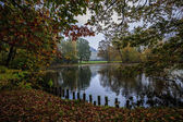 Autumn park, pond and gardens with castle in Pszczyna, Poland