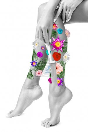 Photo for Shaving female legs. Womans legs in flowers. Isolated on white - Royalty Free Image