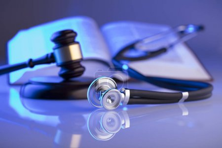 Medical law concept. Gavel, stethoscope, blue ligh...