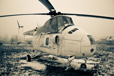 ULYANOVSK, RUSSIA - 9 DECEMBER 2012. An Aeroflot helicopter in Ulyanovsk Aircraft Museum in winter. Low color saturation for a faded retro or vintage effect and a foggy weather
