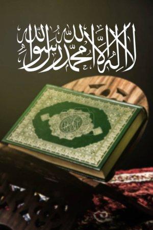 "Islamic term  ""lailahaillallah "", Also called shahada, on  koran background ( Blur effect filter )"