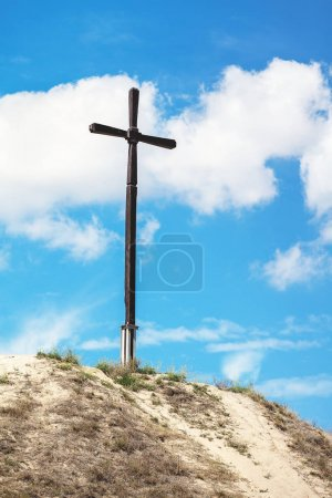 High wooden cross on the hill