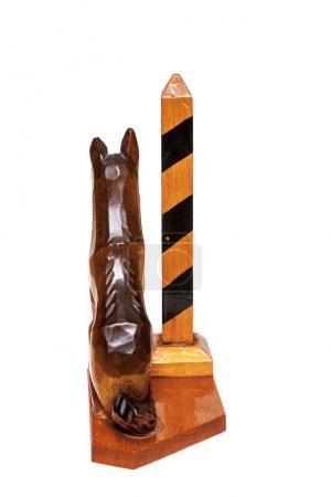 Wooden dog and border pillar on white background