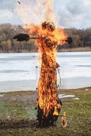 Burning straw effigy Shrovetide festival