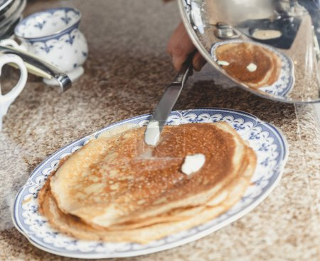 Fried pancake smear with butter