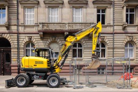 yellow exacavator in urban environment wacker neuson