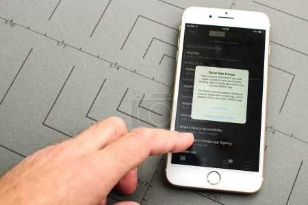 New iPhone 7 Plus with hand touching screen to permit app usage