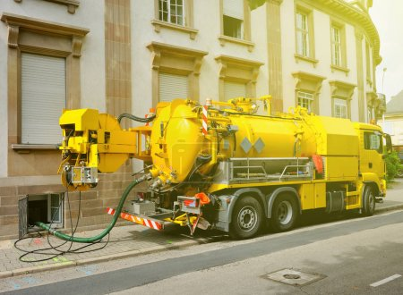 Working Sewage truck working in urban city environment