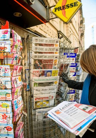 Woman purchases US press newspaper