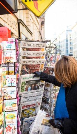 Woman purchases a Suddeutsche Zeitung