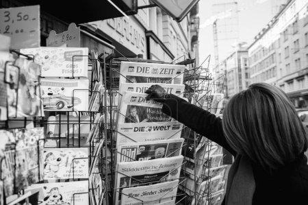 Woman purchases a Die Zeit