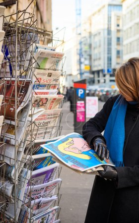 Woman purchases Charlie Hebdo Trump