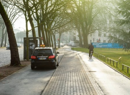 mercedes-Benz taxi and cyclist on special lane