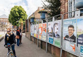People admiring the elections posters on the voting day