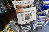 Man buying Suddeutsche Zeitung with the newly elected French pre