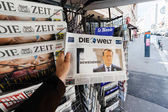 Man buying Die Welt with the newly elected French president Emma