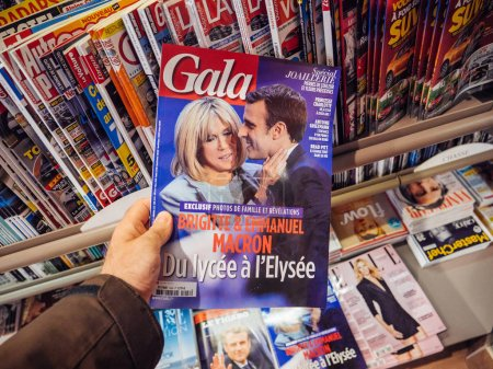 Photo for PARIS, FRANCE - MAY 15, 2017: Man buys Gala magazine with Emmanuel Macron and his wife Brigitte Trogneux during handover ceremony presidential inauguration of the newly elected French President Emmanuel Macron in Paris, France - Royalty Free Image