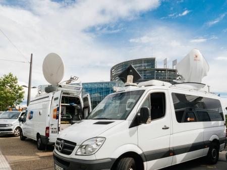 Media TV truck van parked