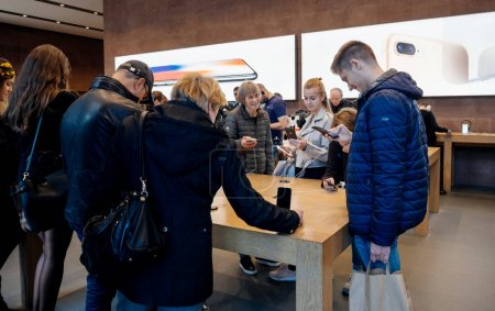 Adults and seniors enjoying the latest Apple iphone X at Store
