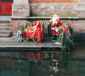Statues of Santa Claus and his donkey ready for Christmas in Col
